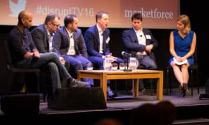 multiple speakers in a panel discussion at conference